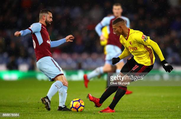 Richarlison de Andrade of Watford and Phil Bardsley of Burnley in action during the Premier League match between Burnley and Watford at Turf Moor on...