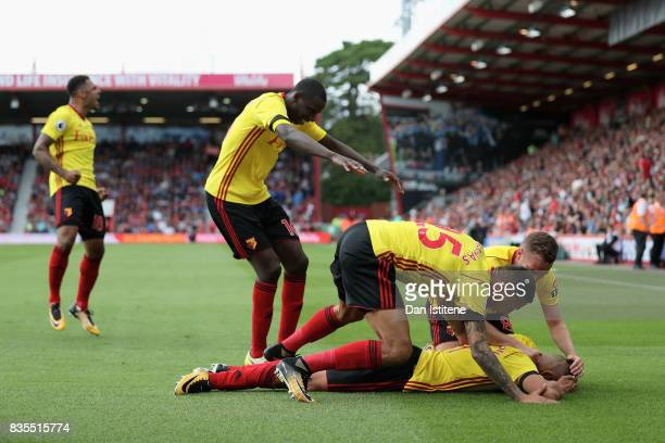 Richarlison de Andrade of Watford celebrates scoring his sides first goal with his Watford team mates during the Premier League match between AFC...