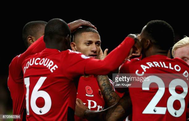 Richarlison de Andrade of Watford celebrates scoring his sides first goal with his Watford team mates during the Premier League match between Everton...