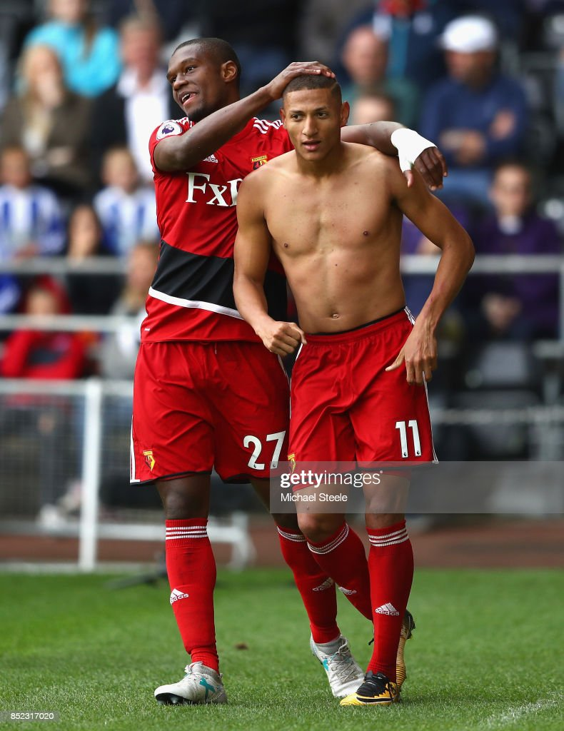 Richarlison de Andrade (R) of Watford celebrates scoring his side's second goal with his team mate Christian Kabasele (L) during the Premier League match between Swansea City and Watford at Liberty Stadium on September 23, 2017 in Swansea, Wales.