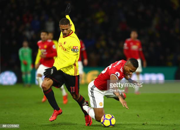 Richarlison de Andrade of Watford challenges Antonio Valencia of Manchester United during the Premier League match between Watford and Manchester...