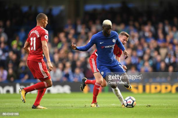 Richarlison de Andrade of Watford chases down Tiemoue Bakayoko of Chelsea during the Premier League match between Chelsea and Watford at Stamford...