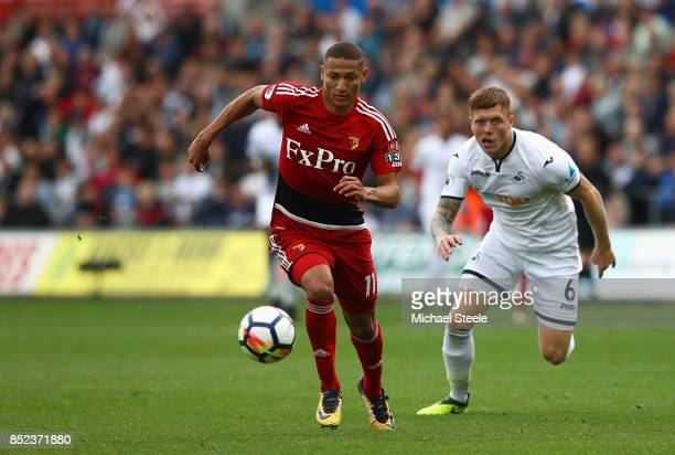 Richarlison de Andrade of Watford controls the ball under pressure of Alfie Mawson of Swansea City during the Premier League match between Swansea...