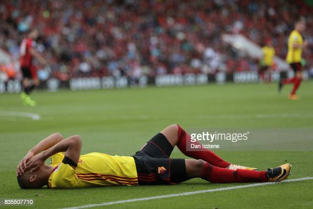 Richarlison de Andrade of Watford goes down injured holding his face during the Premier League match between AFC Bournemouth and Watford at Vitality...