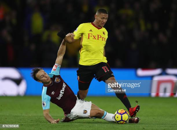 Richarlison de Andrade of Watford is challenged by Mark Noble of West Ham United during the Premier League match between Watford and West Ham United...