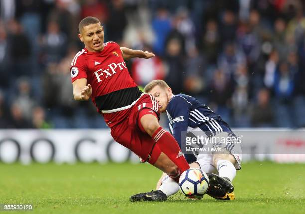 Richarlison de Andrade of Watford is tackled by James McClean of West Bromwich Albion during the Premier League match between West Bromwich Albion...