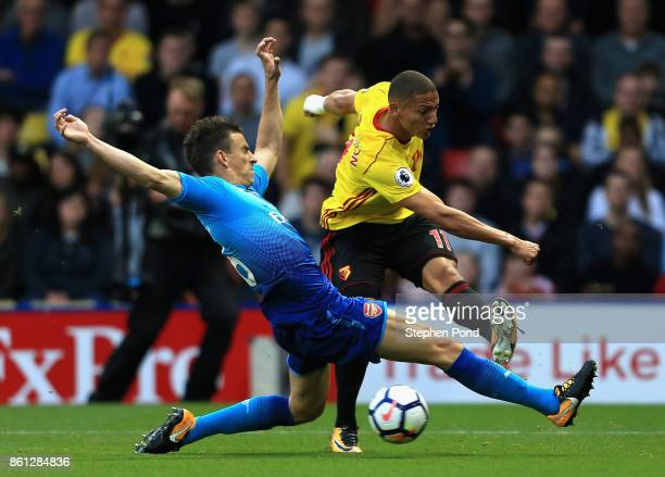 Richarlison de Andrade of Watford sees his shot blocked by Laurent Koscielny of Arsenal during the Premier League match between Watford and Arsenal...