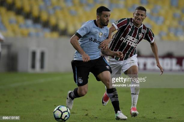Richarlison of Fluminense battles for the ball with Edilson of Gremio during the match between Fluminense and Gremio as part of Brasileirao Series A...