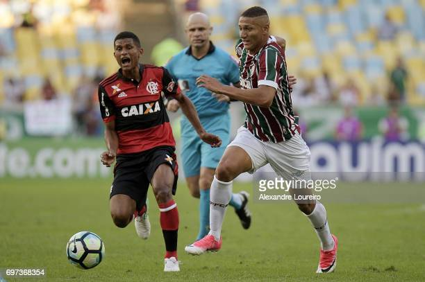 Richarlison of Fluminense battles for the ball with Marcio Araujo of Flamengo during the match between Fluminense and Flamengo as part of Brasileirao...