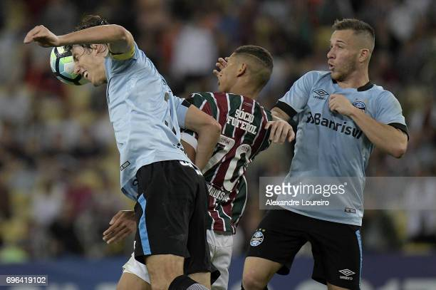 Richarlison of Fluminense battles for the ball with Pedro Geromel and Arthur of Gremio during the match between Fluminense and Gremio as part of...