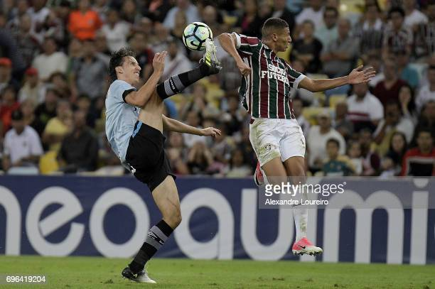 Richarlison of Fluminense battles for the ball with Pedro Geromel of Gremio during the match between Fluminense and Gremio as part of Brasileirao...