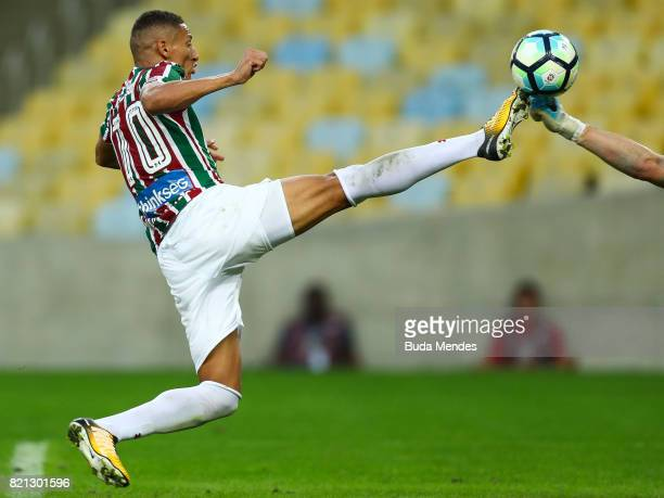 Richarlison of Fluminense struggles for the ball with goalkeeper Cassio of Corinthians during a match between Fluminense and Corinthians as part of...