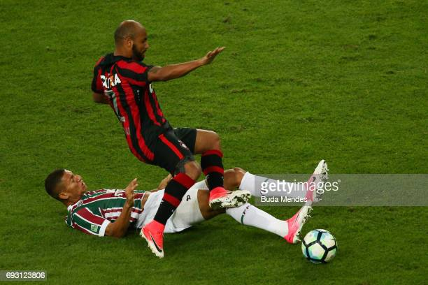 Richarlison of Fluminense struggles for the ball with Jonathan of Atletico PR during a match between Fluminense and Atletico PR as part of...
