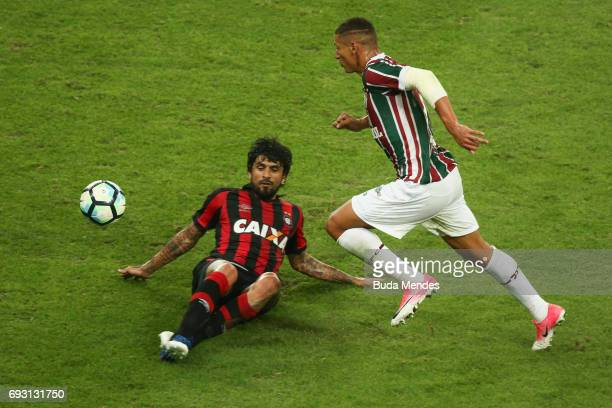 Richarlison of Fluminense struggles for the ball with Lucho González of Atletico PR during a match between Fluminense and Atletico PR as part of...
