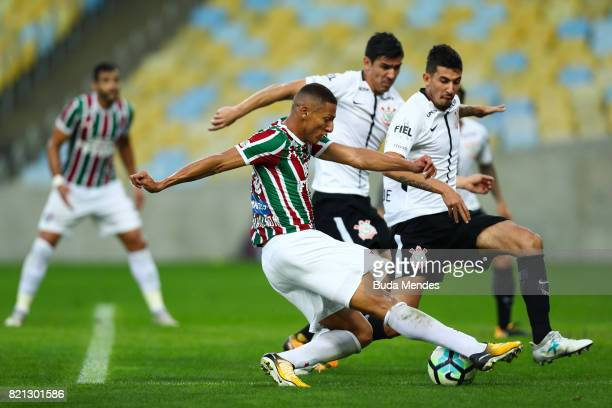 Richarlison of Fluminense struggles for the ball with Pedro Henrique of Corinthians during a match between Fluminense and Corinthians as part of...
