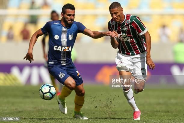 Richarlison of Fluminense struggles for the ball with Thiago Maia of Santos during a match between Fluminense and Santos as part of Brasileirao...