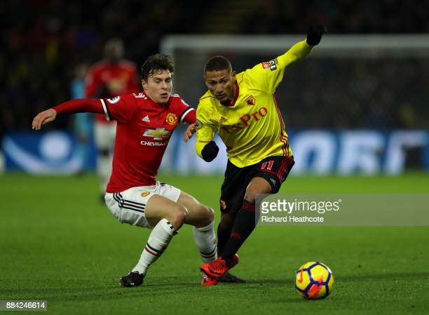 Richarlison of Watford goes past Victor Lindelof of Manchester United during the Premier League match between Watford and Manchester United at...