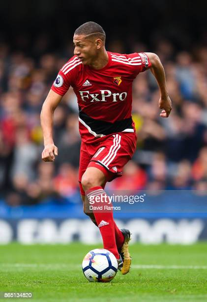 Richarlison of Watford runs with the ball during the Premier League match between Chelsea and Watford at Stamford Bridge on October 21 2017 in London...