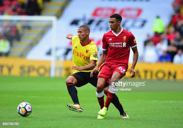 Richarlison of Watford tackles Trent AlexanderArnold of Liverpool during the Premier League match between Watford and Liverpool at Vicarage Road on...