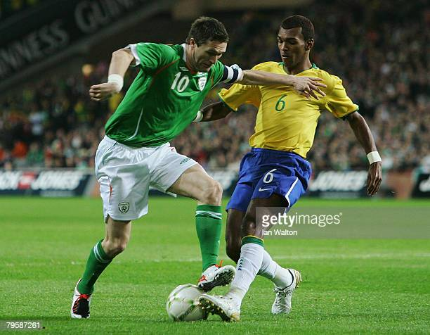 Richarlyson Felisbino of Brazil tries to tackle Robert Keane of Ireland during the International Friendly match between Republic of Ireland and...