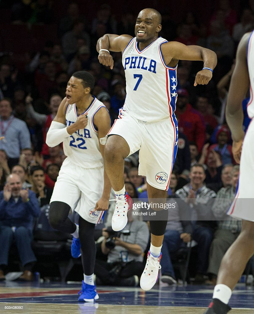 Richaun Holmes and Carl Landry of the Philadelphia 76ers react after a made basket in the game against the Minnesota Timberwolves on January 4 2016...