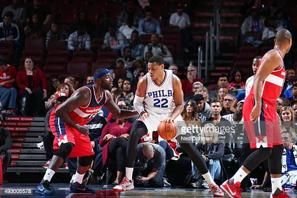 Richaun Holmes of the Philadelphia 76ers drives to the basket against the Washington Wizards during the preseason game on October 16 2015 at Wells...