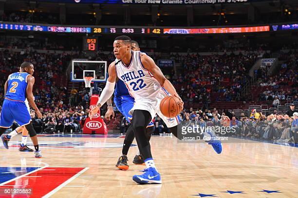 Richaun Holmes of the Philadelphia 76ers drives to the basket against the New York Knicks at Wells Fargo Center on December 18 2015 in Philadelphia...