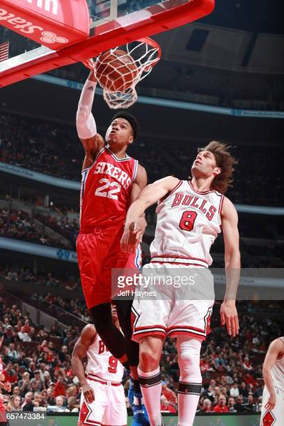 Richaun Holmes of the Philadelphia 76ers dunks against Robin Lopez of the Chicago Bulls during the game on March 24 2017 at the United Center in...