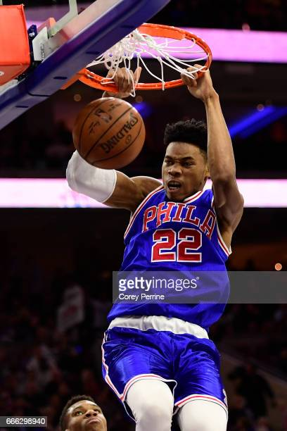 Richaun Holmes of the Philadelphia 76ers dunks against the Milwaukee Bucks during the second quarter at the Wells Fargo Center on April 8 2017 in...