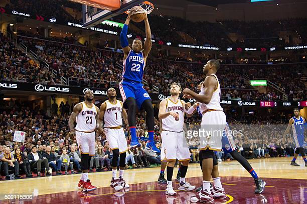 Richaun Holmes of the Philadelphia 76ers dunks during the first half against the Cleveland Cavaliers at Quicken Loans Arena on December 20 2015 in...