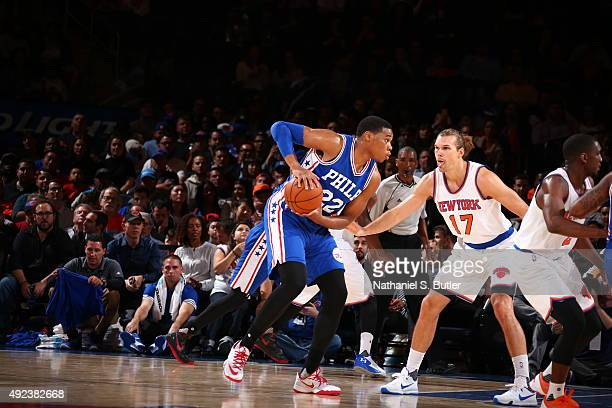 Richaun Holmes of the Philadelphia 76ers handles the ball against Lou Amundson of the New York Knicks on October 12 2015 at Madison Square Garden in...