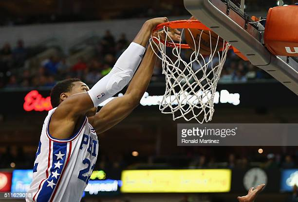 Richaun Holmes of the Philadelphia 76ers makes a slam dunk against the Dallas Mavericks in the first half at American Airlines Center on February 21...