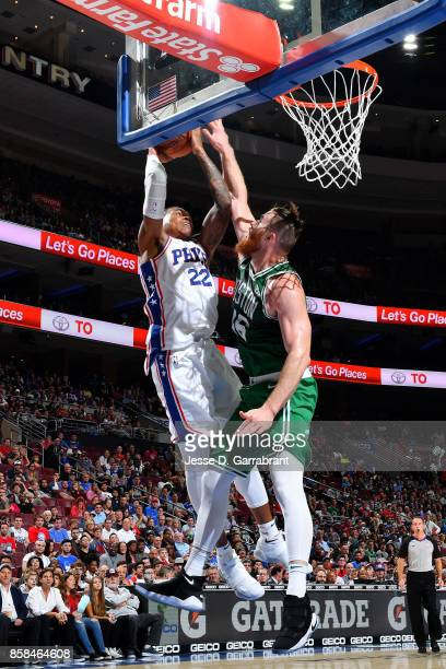 Richaun Holmes of the Philadelphia 76ers shoots the ball against Aron Baynes of the Boston Celtics during a preseason on October 6 2017 at Wells...