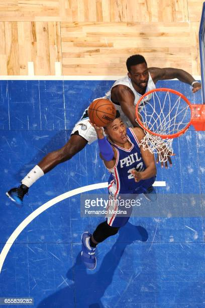 Richaun Holmes of the Philadelphia 76ers shoots the ball against Jeff Green of the Orlando Magic during the game on March 20 2017 at Amway Center in...