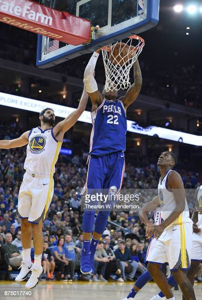 Richaun Holmes of the Philadelphia 76ers slam dunks the ball in front of Omri Casspi of the Golden State Warriors during an NBA basketball game at...