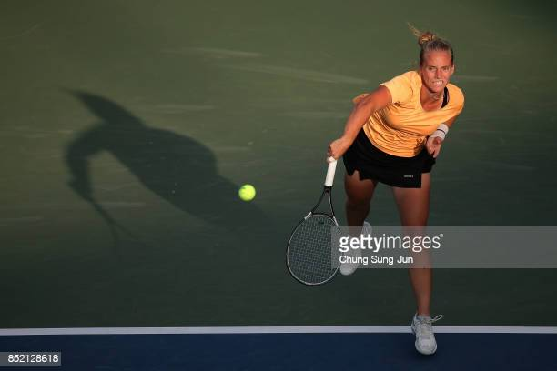 Richel Hogenkamp of Netherlands serves against Beatriz Haddad Maia of Brazil during day six of the KEB Hana Bank Incheon Airport Korea Open at the...