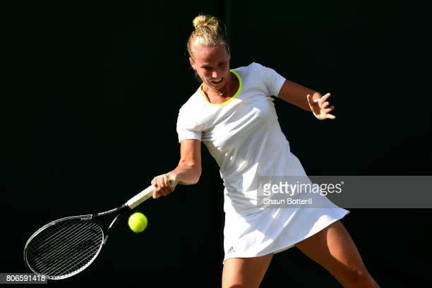 Richel Hogenkamp of the Netherlands plays a forehand during the Ladies Singles first round match against Madison Brengle of the United States on day...