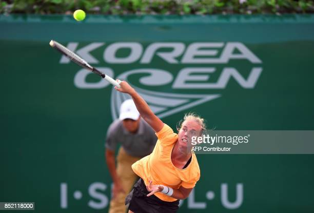 Richel Hogenkamp of the Netherlands serves against Beatriz Haddad Maia of Brazil during their women's singles semifinal match at the WTA Korea Open...