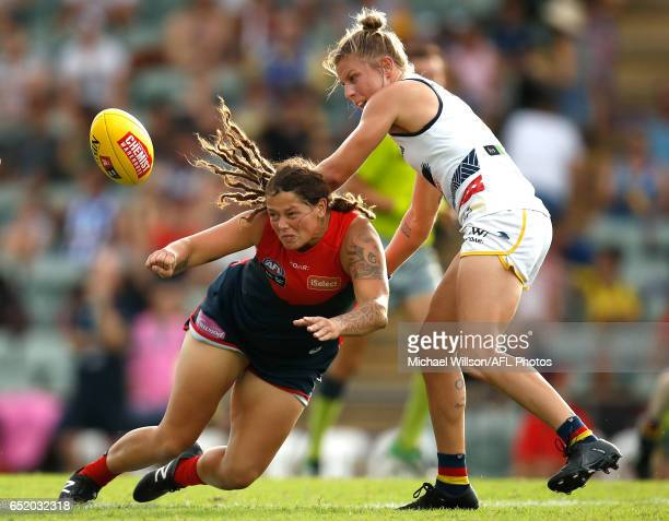Richelle Cranston of the Demons and Kellie Gibson of the Crows compete for the ball during the 2017 AFLW Round 06 match between the Adelaide Crows...