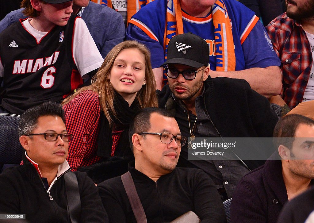 Richie Akiva and guest attend the Miami Heat vs New York Knicks game at Madison Square Garden on February 1 2014 in New York City
