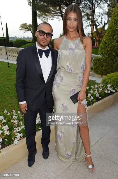Richie Akiva and Lorena Rae arrive at the amfAR Gala Cannes 2017 at Hotel du CapEdenRoc on May 25 2017 in Cap d'Antibes France