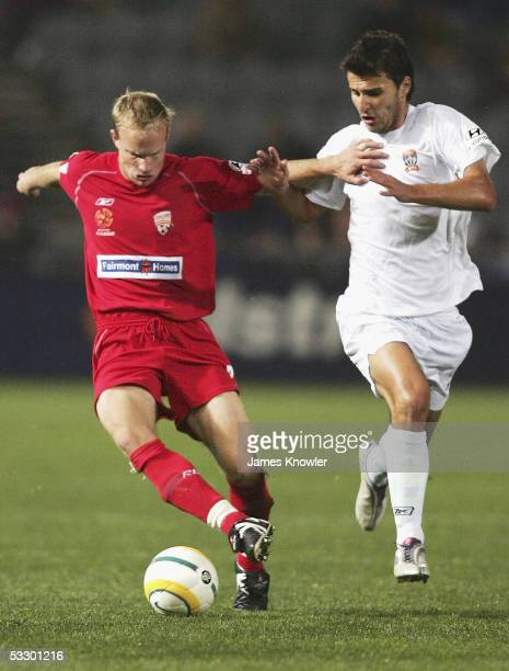 Richie Alagich of Adelaide and Labinot Haliti of Jets in action during the Hyundai ALeague preseason match between Adelaide United FC and Newcastle...
