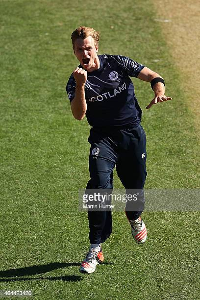 Richie Berrington of Scotland celebrates dismissing Najibullah Zadran of Afghanistan during the 2015 ICC Cricket World Cup match between Afghanistan...