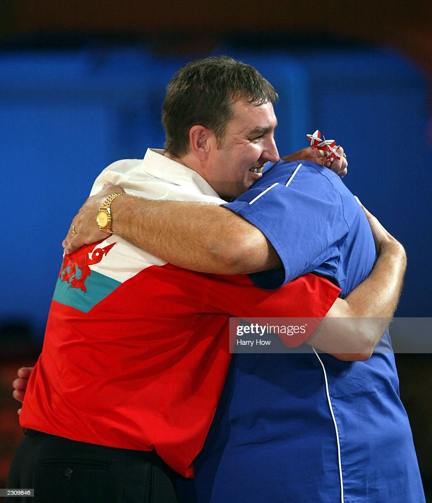 richie burnett gets a hug from cliff lazarenko pictures getty images