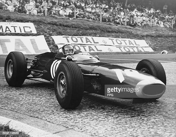 Richie Ginther of the United States drives the Owen Racing Organisation BRM P261 BRM over the cobbles during the French Grand Prix on 28 June 1964 on...