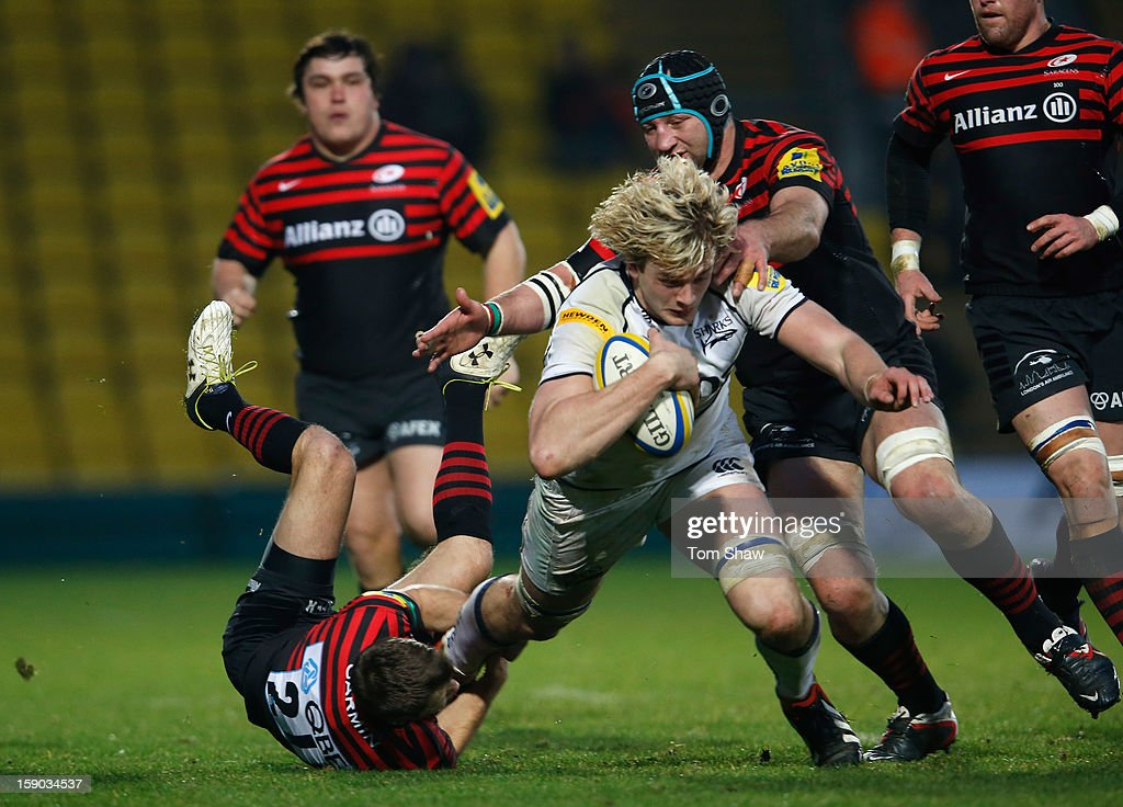 Richie Gray of Sale is tackled during the Aviva Premiership match between Saracens and Sale Sharks at Vicarage Road on January 6, 2013 in Watford, England.