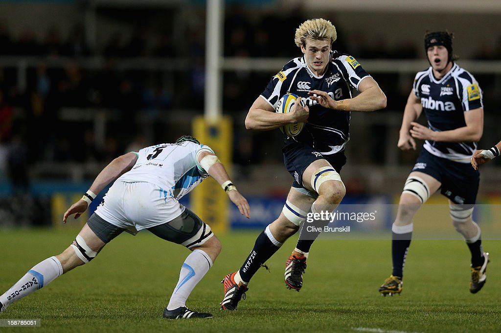 Richie Gray of Sale Sharks attempts to move past Chris Jones of Worcester Warriors during the Aviva Premiership match between Sale Sharks and Worcester Warriors at Salford City Stadium on December 28, 2012 in Salford, England.