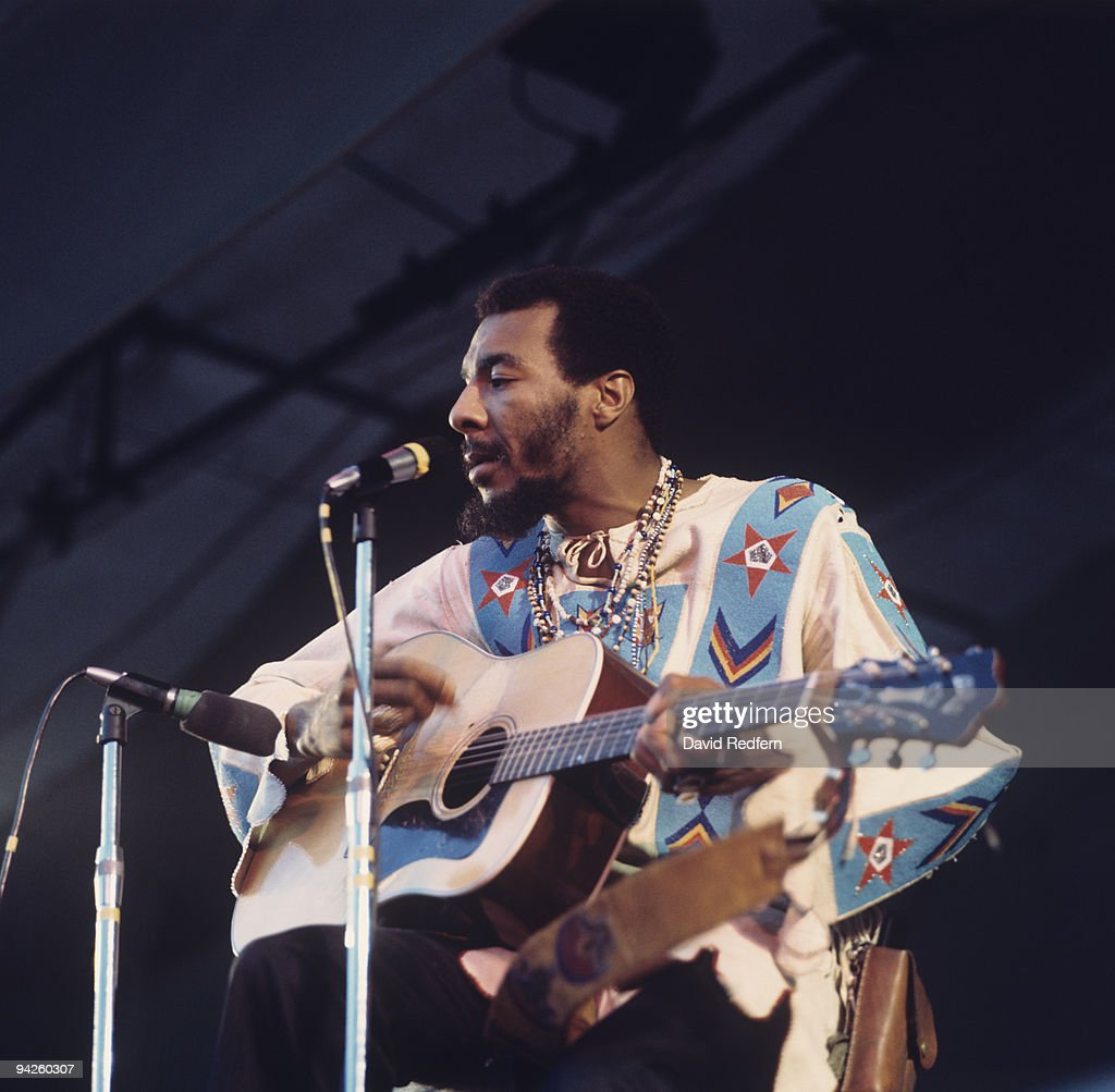 Richie Havens performs on stage at the Isle of Wight Festival on August 31, 1969.