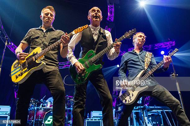 Richie Malone Francis Rossi and John 'Rhino' Edwards of Status Quo perform at The O2 Arena on December 11 2016 in London England