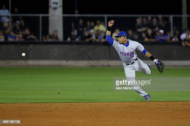 Richie Martin of the Florida Gators lets the ball get past him during an NCAA baseball game against the UCF Knights at Jay Bergman Field on March 3...
